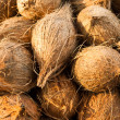 Fresh coconuts at market place — Stock Photo