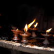 Foto Stock: Burning oil lamps. Nepal