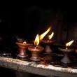 Burning oil lamps. Nepal — Stock Photo