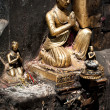 Stock Photo: Golden sculpture of praying man. Nepal