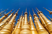 Golden stupas of Shwe Indein Pagoda over blue sky. Myanmar (Burma) — Stock Photo