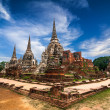 Ancient pagoda at Wat Phra Sri Sanphet temple under blue sky. Ayutthaya, Thailand — Stock Photo #43240887