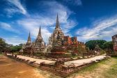 Ancient pagoda at Wat Phra Sri Sanphet temple under blue sky. Ayutthaya, Thailand — Stock Photo