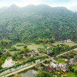 Vietnamese village among rice fields — Stock Photo
