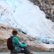 Stock Photo: Girl looking at the glacier