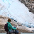 Girl looking at the glacier — Stock Photo