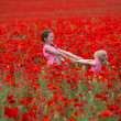 Girls with poppies — Stock Photo