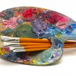 Pallette with brushes — Stock Photo