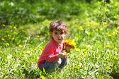 Girl with dandelions — Stock Photo