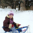 Girl on a sledge — Stock Photo