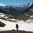 Stock Photo: Hiker on rise
