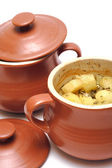 Stewed potatoes at the pot — Stock Photo