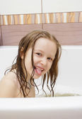 Joying little girl taking a bath — Stock Photo