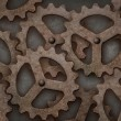 Distressed interlocking gears — Stock Photo