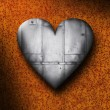 Sheet Metal Heart Against a Rusty Background — Stock Photo