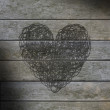 Stock Photo: Heart scribbled on gray weathered wood