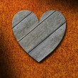 Weathered gray wood heart against rusty metal background — Stock Photo #21367853