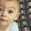 Stock Photo: Baby facing camersurrounded by distorted screens of O