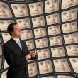 Stock Photo: Min suit monitoring babies on distorted video screens