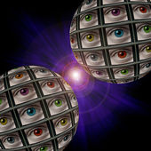 Two sphere of video screens showing multi-colored eyes — Stock Photo
