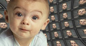 A baby facing the camera surrounded by distorted screens of an O — Stock Photo
