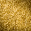 Stock Photo: Yellow packing straw material lit diagonally