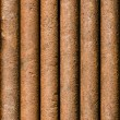 Stock Photo: Vertical rusty pipe background seamlessly tileable