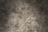 Distressed metal surface texture lit dramatically — Stock Photo