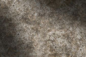 Distressed metal surface texture lit diagonally — Stock Photo