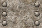 Nödställda metall ytstruktur med två rader med nitar seamles — Stockfoto