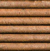 Horizontal rusty pipe background seamlessly tileable — Stock Photo