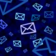 Stock Photo: Email message icons floating in blue cyberspace