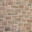 Reddish masonry block wall — Stock Photo