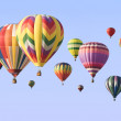 A group of colorful hot-air balloons floating — Stock Photo