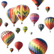 Stock Photo: Colorful hot-air balloons floating against white