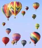 Hot-air balloons arranged around edge of frame — Stock Photo