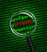 Magnifying glass locating spyware in computer code — Stock Photo
