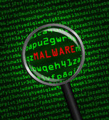 Magnifying glass locating malware in computer code — Stock Photo