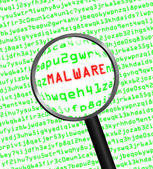 Magnifying glass locating malware in computer code — Photo