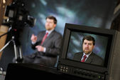 Monitor in production studio showing man talking into a televisi — Stock Photo