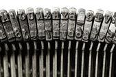 Close-up of vintage typewriter letter & symbol keys — Stock Photo