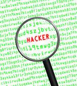 """通过放大镜的计算机代码中显示的""""黑客 — 图库照片"""