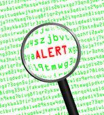 """""""alerta"""", revelada em código de computador por meio de uma lupa — Fotografia Stock"""
