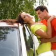 Man embraces a young girl at the car - Stock Photo