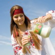 Stock Photo: Girl in national Ukrainishirt drinking milk