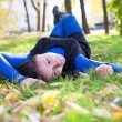 Girl lying on the grass in the park — Stock Photo