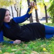 Girl lying on the grass in the park — Foto de Stock