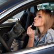 Stock Photo: Emotional blonde behind wheel lipstick