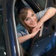 Blonde at the wheel of a car — Stock Photo