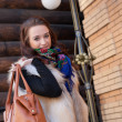 Stock Photo: Portrait of cheerful young womwith bag